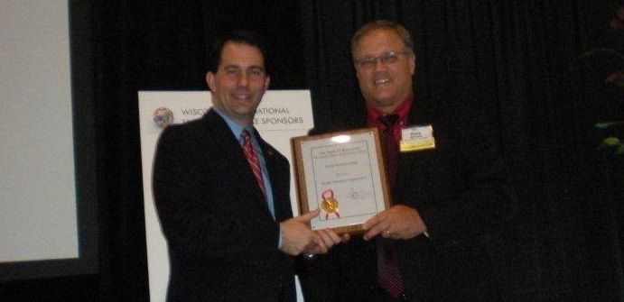 Hydro-Thermal International Sales Manager, Gary Bymers, Accepting Governor's Export Achievement Award from Governor Scott Walker